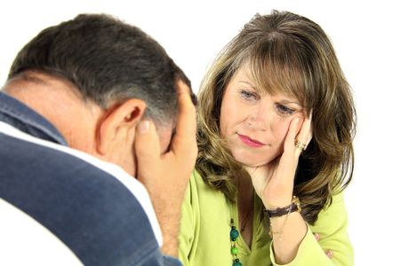 Upset and emotional middle aged couple after an argument.