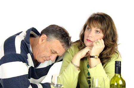 confab: Dejected middle aged couple after having had an argument.