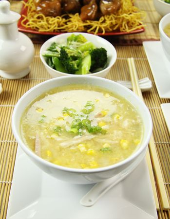 Delicious chicken and corn soup with asian vegetables and noodles.