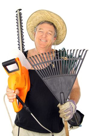 Happy middle aged gardener carrying an array of gardening tools. photo