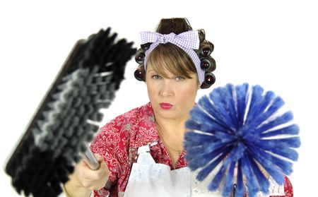 Frumpy housewife armed to the teeth with brush and broom ready for action. photo