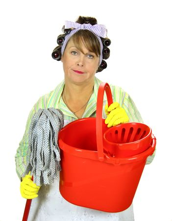 dreary: Frumpy unhappy middle aged housewife with a mop and bucket. Stock Photo