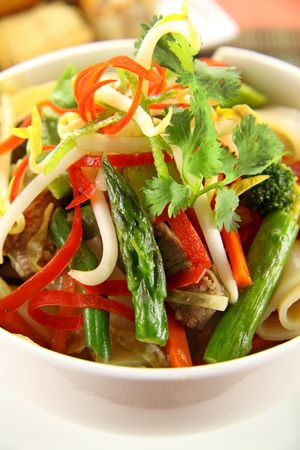 freshly prepared: Freshly prepared beef noodle stirfry with dimsums ready to serve. Stock Photo
