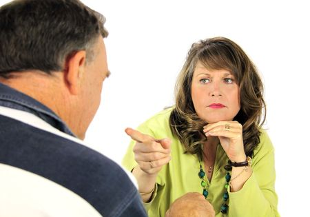 Middle aged arguing couple pointing and accusing each other. Stock Photo