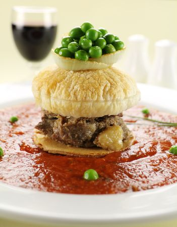 floater: Short beef pie floater with peas floating in tomato sauce.