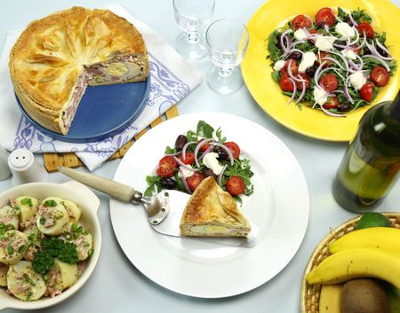 Delicious baked ham and egg pie with potato and salad ready to serve. Stock Photo - 6761851