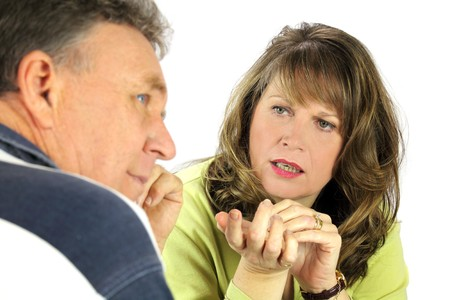 confab: Man looking away while being questioned by his spouse. Stock Photo