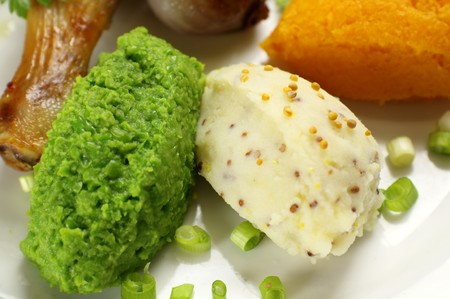 mustard seed: Delicious spoonfuls of mashed green peas with mashed potato with mustard seed. Stock Photo