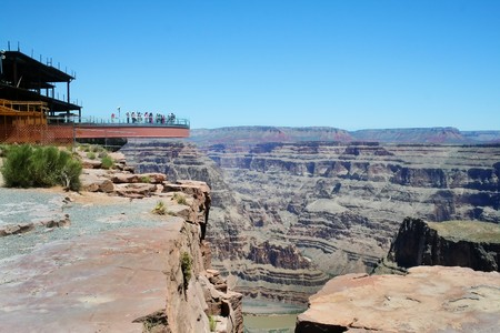 The glass skywalk observation bridge suspended four thousand feet above the Colorado River on the edge of the Grand Canyon West. Stock Photo