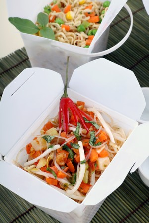 Chili rice noodle vermiceli in take away containers. photo