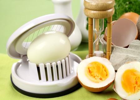 slicer: Egg slicer with boiled eggs and an egg timer.
