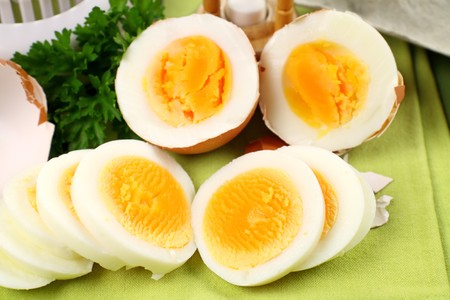 Fresh hard boiled eggs sliced and broken with parsley. Stock Photo - 7040649