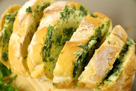 Fresh baked sliced herb and garlic roll from the oven. photo