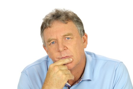 introspective: Casual middle aged man with hand on chin with a concerned look. Stock Photo