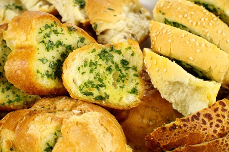 crusty: Delicious homemade herb and garlic crusty bread ready to serve.