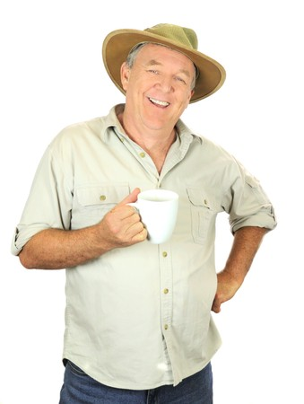 good looking man: Casual middle aged man in a hat smiling with a cup of coffee.