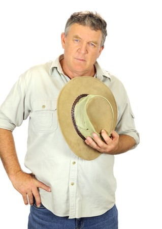 Middle aged man in casual clothes holding a hat to his chest. Stock Photo - 7416649