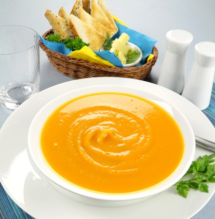 cucurbit: Delicious pumkin soup with a selection of toasts with butter.