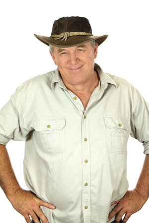 Middle aged man with in a leather hat with hands on hips. photo