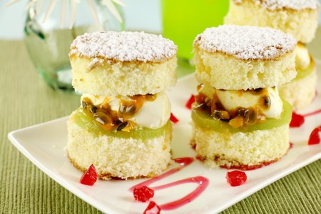 Delicious passionfruit sponge cake stacks served witha strawberry sauce. photo