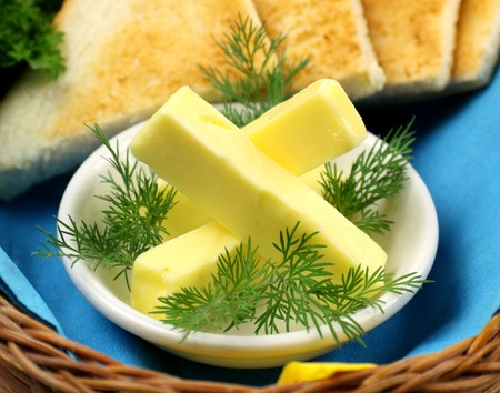 Tray of butter sticks with Italian parsley ready to serve. photo
