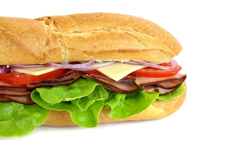 Giant ham, tomato, lettuce, cheese and onion sub ready to serve.