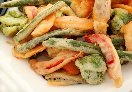 Japanese tempura with fresh vegetables fried in a light batter. photo