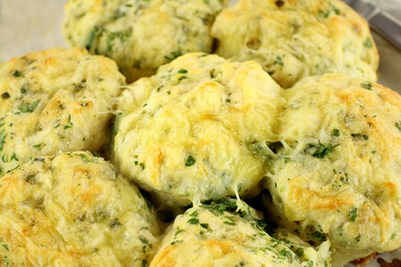 scrumptious: Delicious fresh baked savory cheese and spinach scones ready to serve.