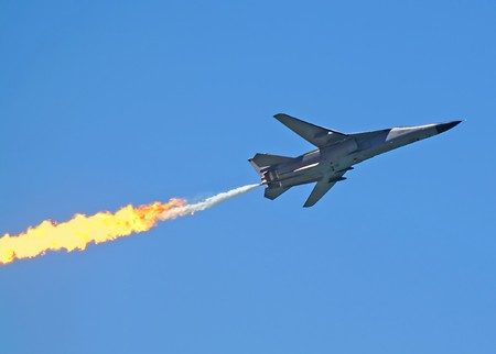 French made Dassault Mirage F 111 fighter bomber in flight with after burner. photo