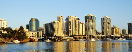 City of Brisbane, Queensland Australia seen from the Brisbane River at sunrise. Stock Photo