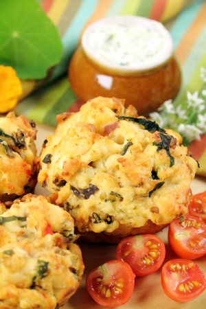 muffins: Fresh baked savory muffins with herb spread and cherry tomatoes.