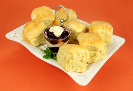 flavorful: Fresh Baked scones with jam and cream on a tray ready to serve. Stock Photo