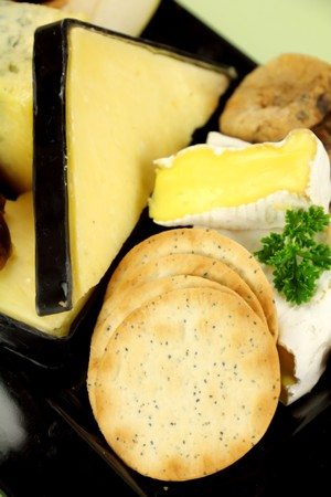 Fresh water crakers with camembert and vintage cheddar cheese ready to serve.
