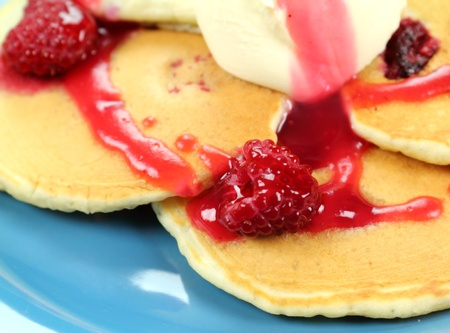 dollop: Delicious raspberries on pancakes with raspberry sauce and a dollop of cream.