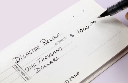 A disaster relief check being written for one thousand dollars.