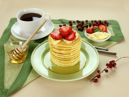 Delicious strawberry pancake stack stack dripping with honey with cream. Stock Photo - 8675418