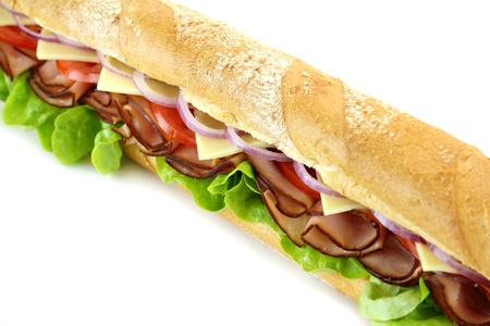 sub sandwich: Giant ham, tomato, lettuce, cheese and onion sub ready to serve.