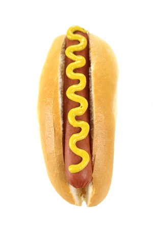 Mustard on a hot dog and bread roll on a white background. photo