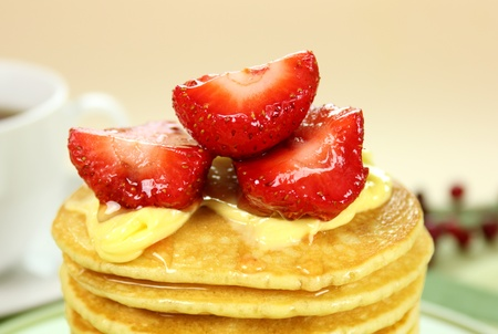 Delicious strawberry pancake stack stack dripping with honey with cream. Stock Photo - 8756452