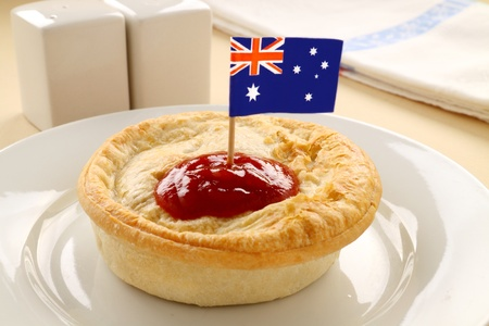 Australian flag on the classic Australian meat pie. Stock Photo