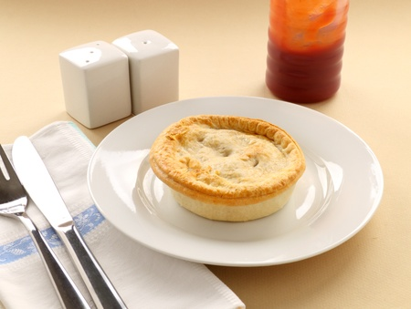 meat pie: The classic Australian meat pie served with tomato sauce,