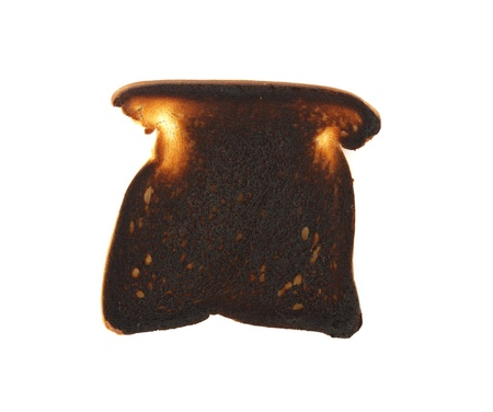 burnt toast: A piece of very burnt toast on white.