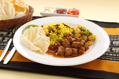 beef curry: Delicious and spicy Indian beef curry served with pappadums.
