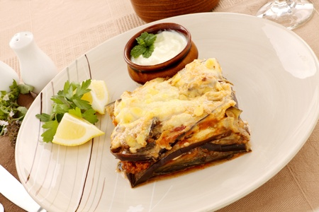 Delicious Greek moussaka with aubergine and a side garden salad. photo