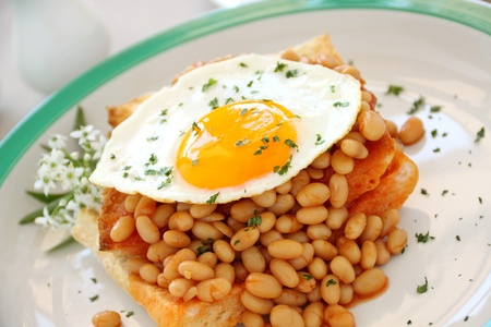 baked beans: Delicious old fashioned breakfast of a fried egg on a baked beans stack on toast.
