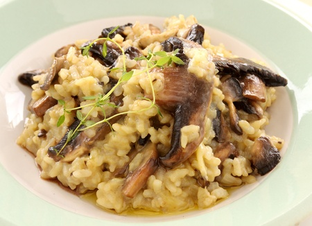 Delicious mushroom risotto served with fresh thyme.
