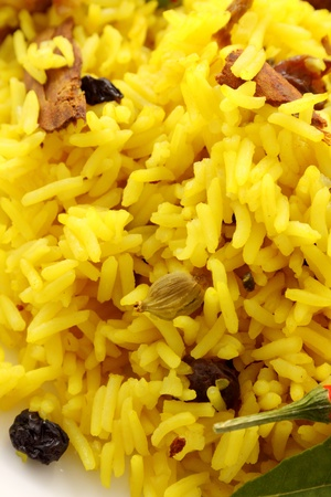 Delicious spicy rice with tumeric, chilli, cardamon and curry leaf. photo