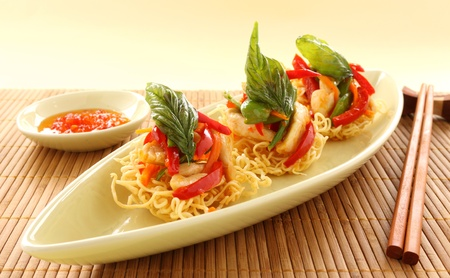 Delicious Asian chilli chicken on beds of crispy noodles.