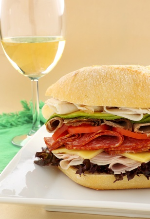 Mega meat roll consisting of ham, salami, roast beef and turkey with cheddar cheese and salad. Stock Photo - 9006297