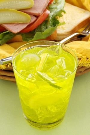 thirst quenching: Thirst quenching iced lemon and lime drink with fruit pieces. Stock Photo
